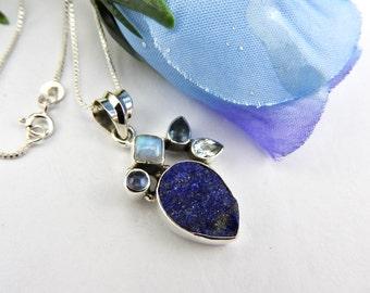 Lapis lazuli rough. Rainbow moonstone. Blue topaz. Sterling silver. Jewelry. Jewellery. Necklace. Pendant. Lapis lazuli. Natural gemstone.