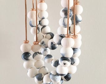 The Delicate Clay Necklace Rose Gold Blush  White Leather Cord