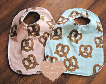 Pretzel Bib in Blue or Pink