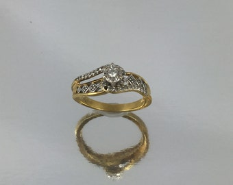 Gold Plated Ring with Large Diamond and Elegant Diamonds on Band