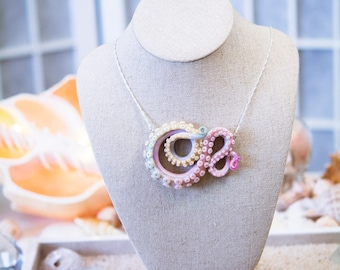 Pastel and marble, glow in the darkTentacle pendant