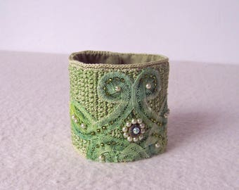 Lime green crocheted bracelet with hand-painted vintage lace.