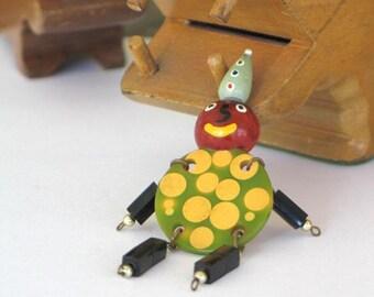 Vintage Bakelite Crib Toy Clown Pin