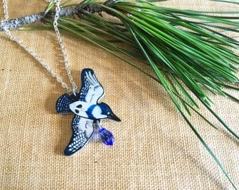 Flying belted kingfisher (Megaceryle alcyon) hand drawn charm necklace