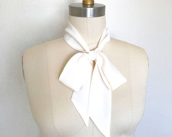 "Ivory skinny scarf in pure silk is 53""x 2""and so versatile. Long and thin to wear in a bow, a sash, choker scarf or as a headscarf."
