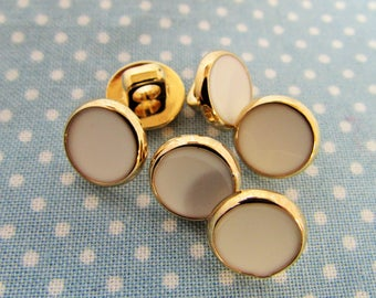 White and gold dress shirt buttons