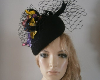 black wool felt perching beret hat  adorned with multi coloured silk flowers,vintage french veiling & sculptured ribboned detail