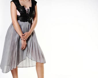 Pleated Organdie Dress And A Leather Waistcoat