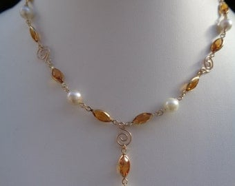 String of pearls in cream, combined with Crystal Y necklace, 585 gold filled