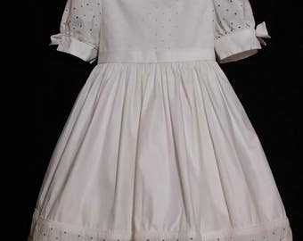 The perfect little girl white eyelet designer vintage dress, with shirt puff bow sleeves.