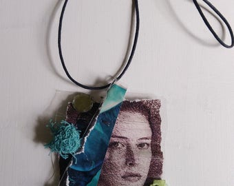 crew neckline with turquoise pendant laminated recycled paper