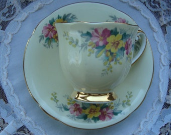 Vintage Windsor Bone China Made in England - Hand Decorated Tea Cup and Saucer - Multifloral on Light Yellow Gold Trim