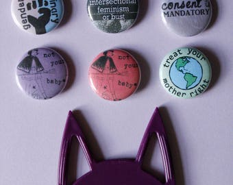 "1"" inch buttons / social justice / intersectional feminism / consent / environmentalism / gender roles"
