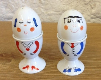 Pair Of Vintage Character Eggcups With Matching Salt Shakers. In Good Condition