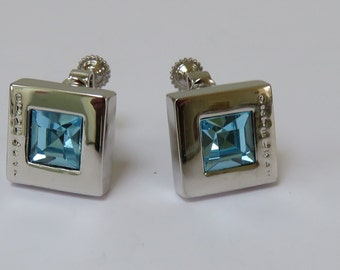 Vintage Givenchy silver tone and blue crystal screw back clip on earrings - 1980s