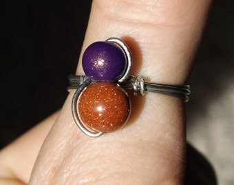 Purple and copper colored ring