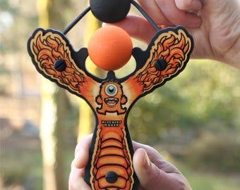 Mischief Maker Slingshot - Lil' Monster Orange