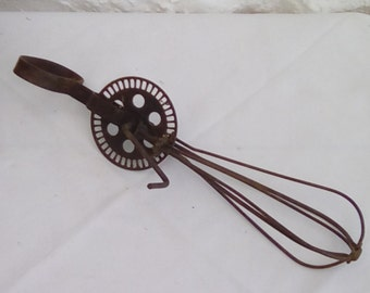 A French vintage whisk or beater.