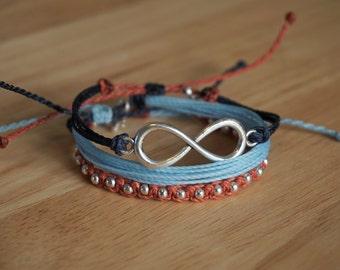 Set of 3 bracelets: Light Blue, Dark Blue & Burnt Orange with Silver Infinity Charm and Silver Beads - wax string friendship bracelets
