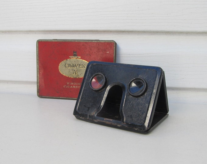 Folding stereoviewer, stereoscopic image viewer, vintage metal optical stereo viewer in Craven A Virginia Cigarettes tin box