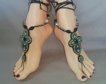 A Pair of Ornate Black, Silver and Rhinestone  Beaded Barefoot Sandals