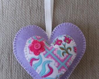 A handmade lilac felt heart hanging decoration