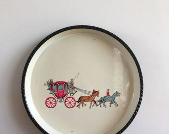 Vintage metal tray with an image of coach and horses