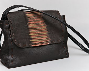 Leather small bag with snake relief pattern on the cover!