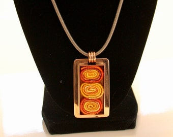 Copper rectangular pendant with hand dyed orange and yellow wool