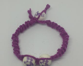 Pink Jute Semi spiral weave with white/purple flower beads