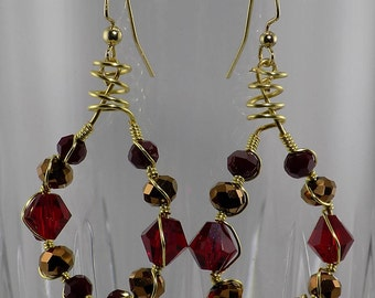 Sparkling red, gold shiny, round dangles
