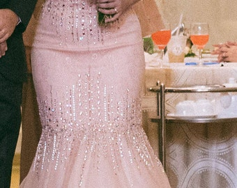 Peach-coloured evening gown with sequins, beading and lace details