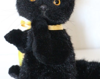 Black little kitten