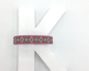 Woven bracelet in pink, green glass beads and leather lace