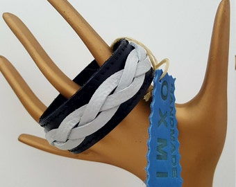 Ladies bracelet. Braided leather.