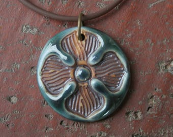 Single Flower on Copper Teal Porcelain Pendant
