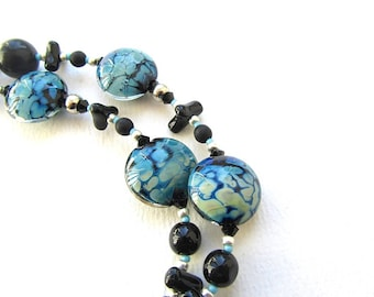 Kronos Necklace, Black and Blue Tasselled Necklace with Artisan Lampwork Glass Beads and Focal