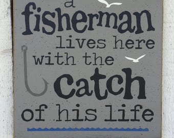 A fisherman lives here with the catch of his life, gift for fisherman, man cave, cabin decor, nautical decor, fishing sign, fishing decor