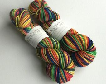 Hand dyed yarn. 100g of hand painted organic merino aran. Dragon's Flight rainbow yarn.  British spun wool yarn. Knitting, crochet.