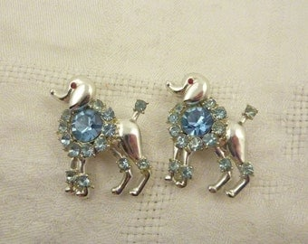 Vintage Pair of Silvertone Fancy Poodle Brooches with Blue Rhinestone Collars