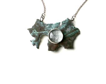 Bronze metal Pendant with natural patina and Glass