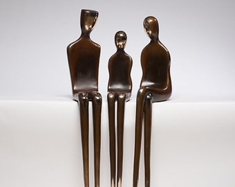outdoor statues figurative sculptures, children and parents, sitting figures, made in Santa Fe