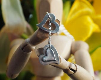 An sweetly simple fine silver two kicking hearts lariat on a sterling silver chain.....