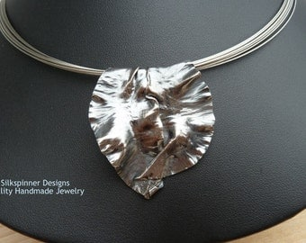 Enigma fold formed Sterling silver pendant with 10-strand steel cable collier