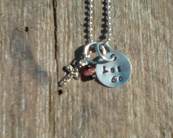 Let Go hand stamped necklace