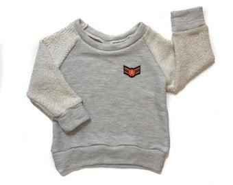 Wings Raglan Sweatshirt.