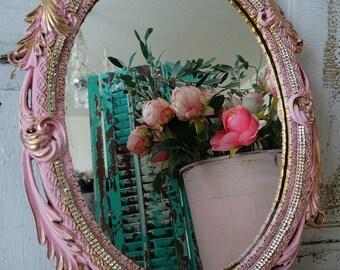 Ornate framed mirror wall hanging pink gold and rhinestone trim shabby cottage chic vintage heavy embellished frame decor anita spero design