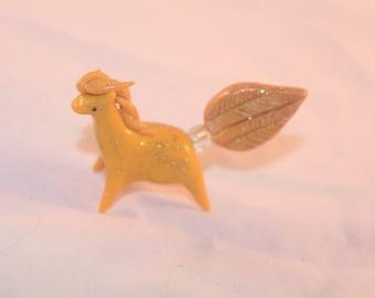 Golden polymer clay horse figurine