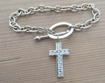 Vintage sterling silver chain bracelet with a cross charm