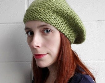 Knitted warm wool green beret for women